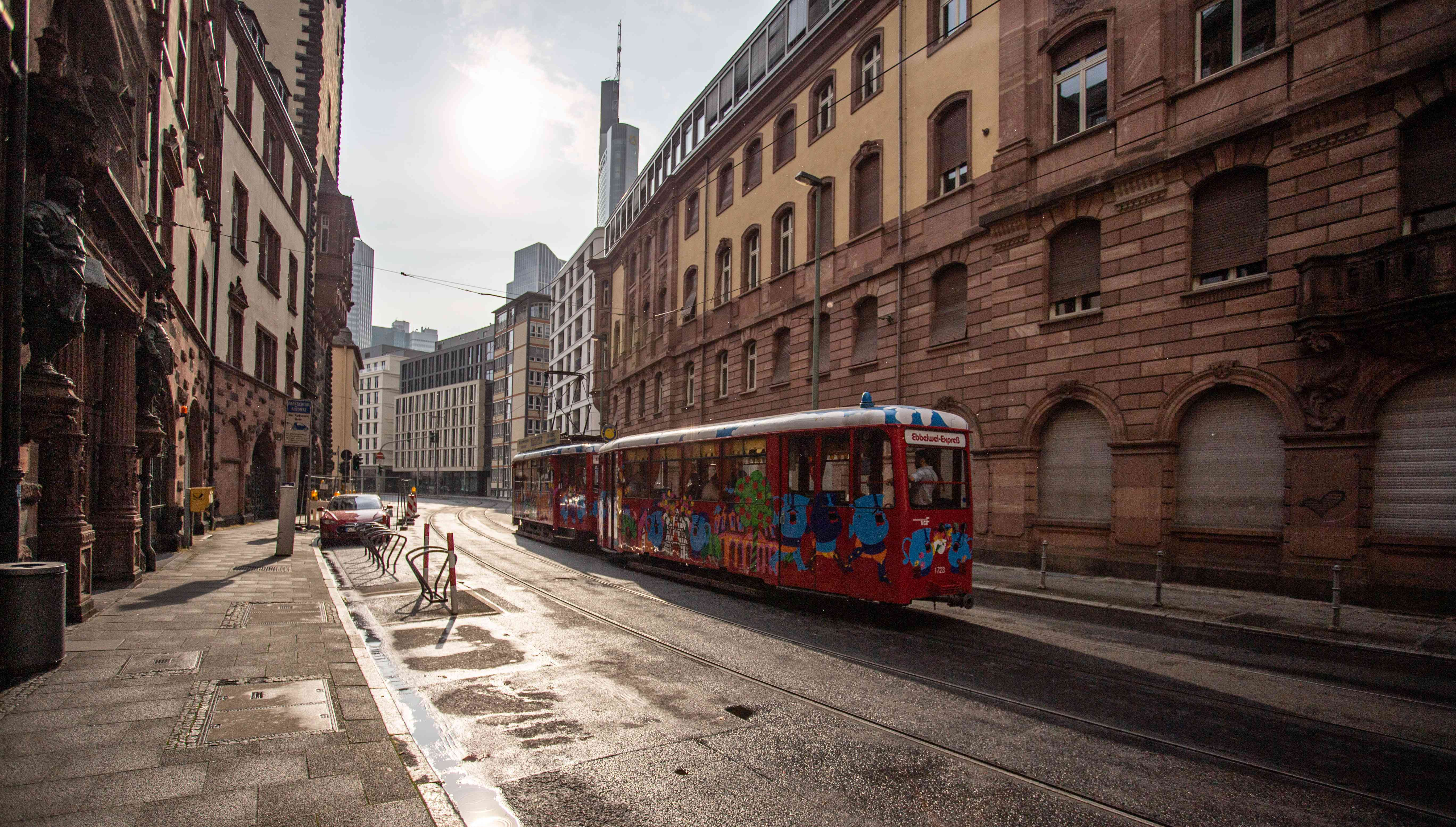 The Apple Cider Express going down an empty street in Frankfurt