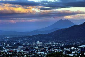 El Salvador, San Salvador, View of Boqueron Volcano Valley, Valley Of Hammocks, San Vincente Volcano and Metropolitan Cathedral Of Holy Savior at sunset