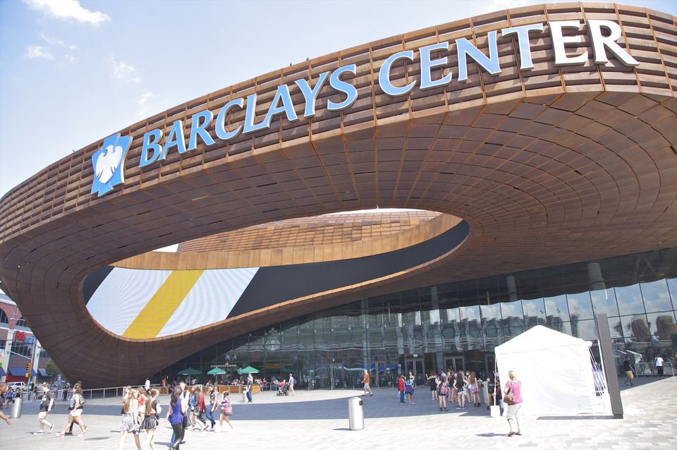 Orange tile oval shape to sport/concert center Barclays Center, Downtown Brooklyn, Kings County, New York, USA. Designed by architecture firms AECOM and SHoP Architects, opened in 2012, now Brooklyn's premier multi-purpose arena. New home of Brooklyn Nets basketball team, and host to many concerts and entertainment events, and future home of New York Islanders hockey team beginning in 2015.