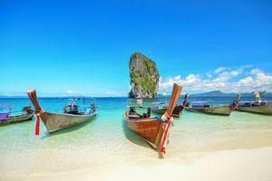 Long tailed boat Ruea Hang Yao park at sea in Phuket Thailand