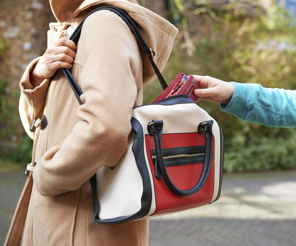 Pickpocket robbing tourist