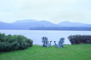 Two Adirondack Chairs Beside Blue Mountain Lake