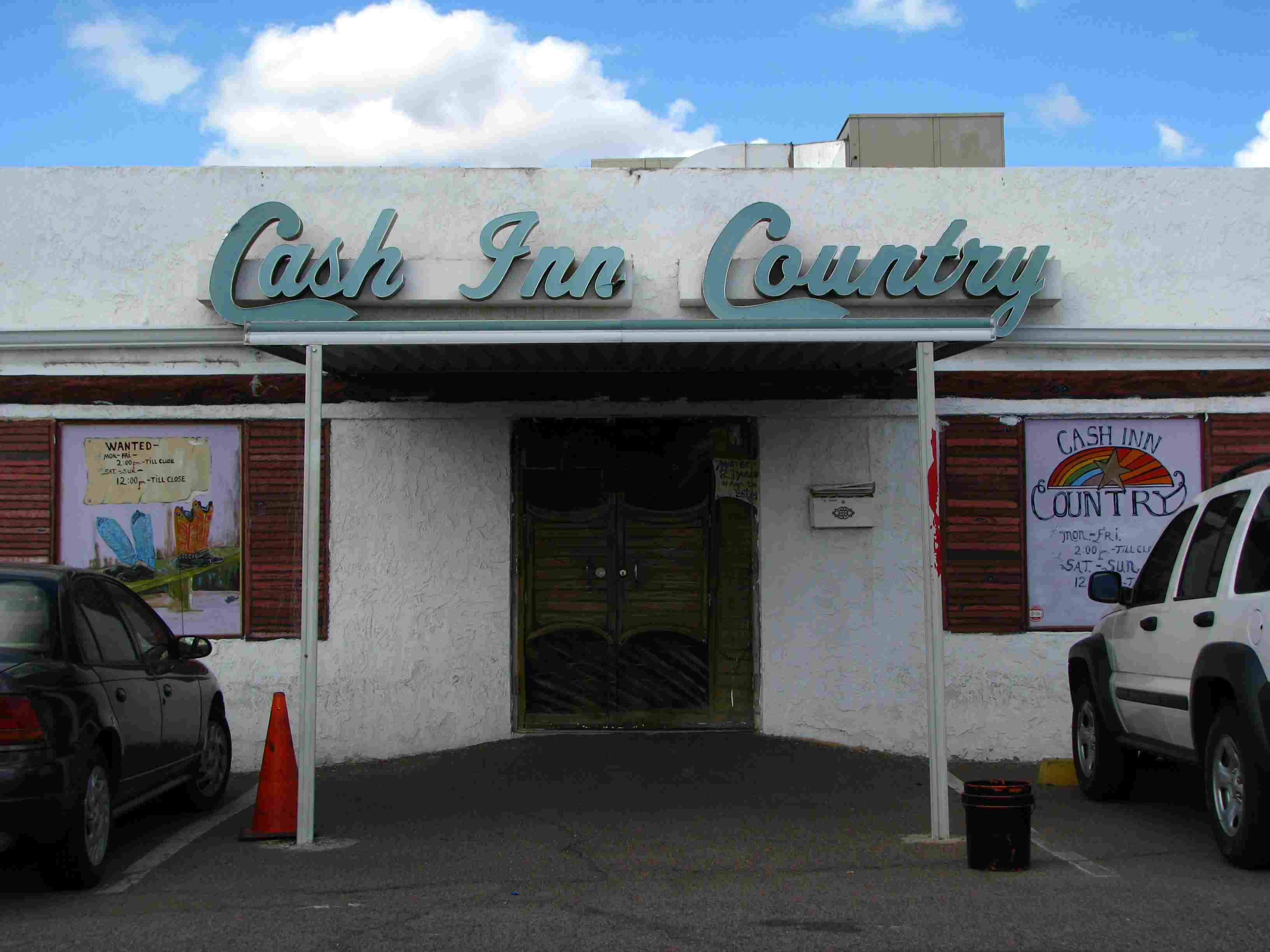 Exterior of Cash Inn Country in Phoenix, AZ with teal signage in a retro  font