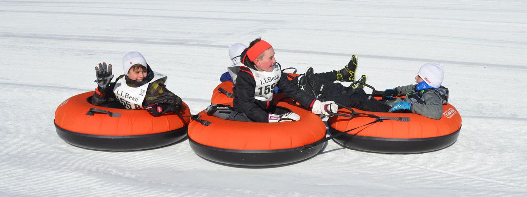 Boys snow tubing at Great Glen Trails