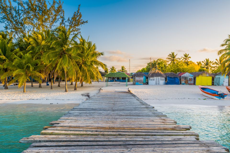 Wooden pier to a tropical beach, Saona island