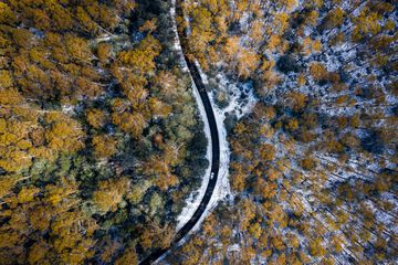 Car Driving on Snow Road Aerial