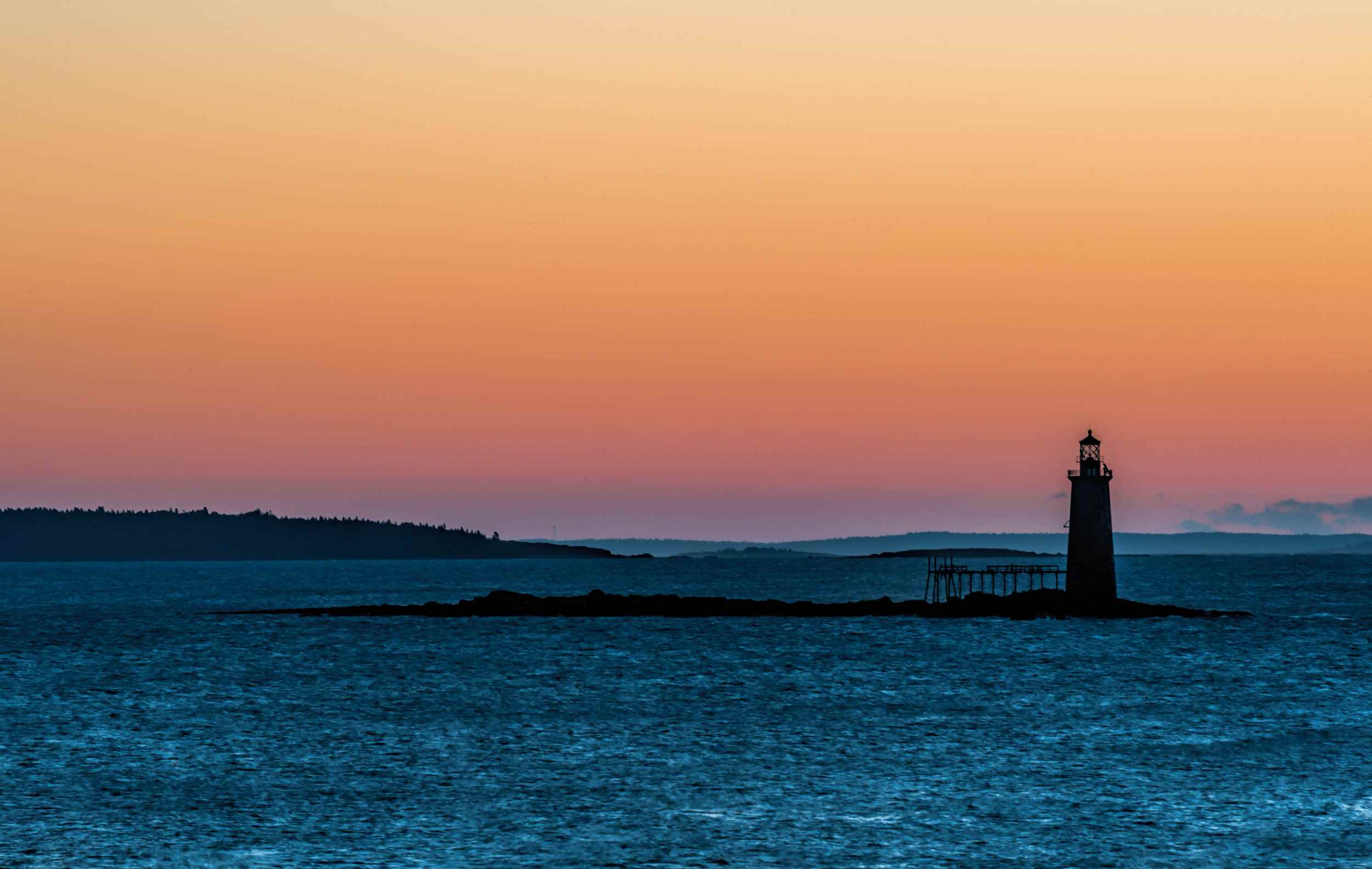Ram Island Ledge Light contra la puesta de sol