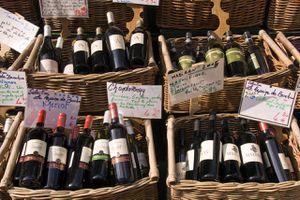 Wine shop in Rue Mouffetard displaying baskets of bottles