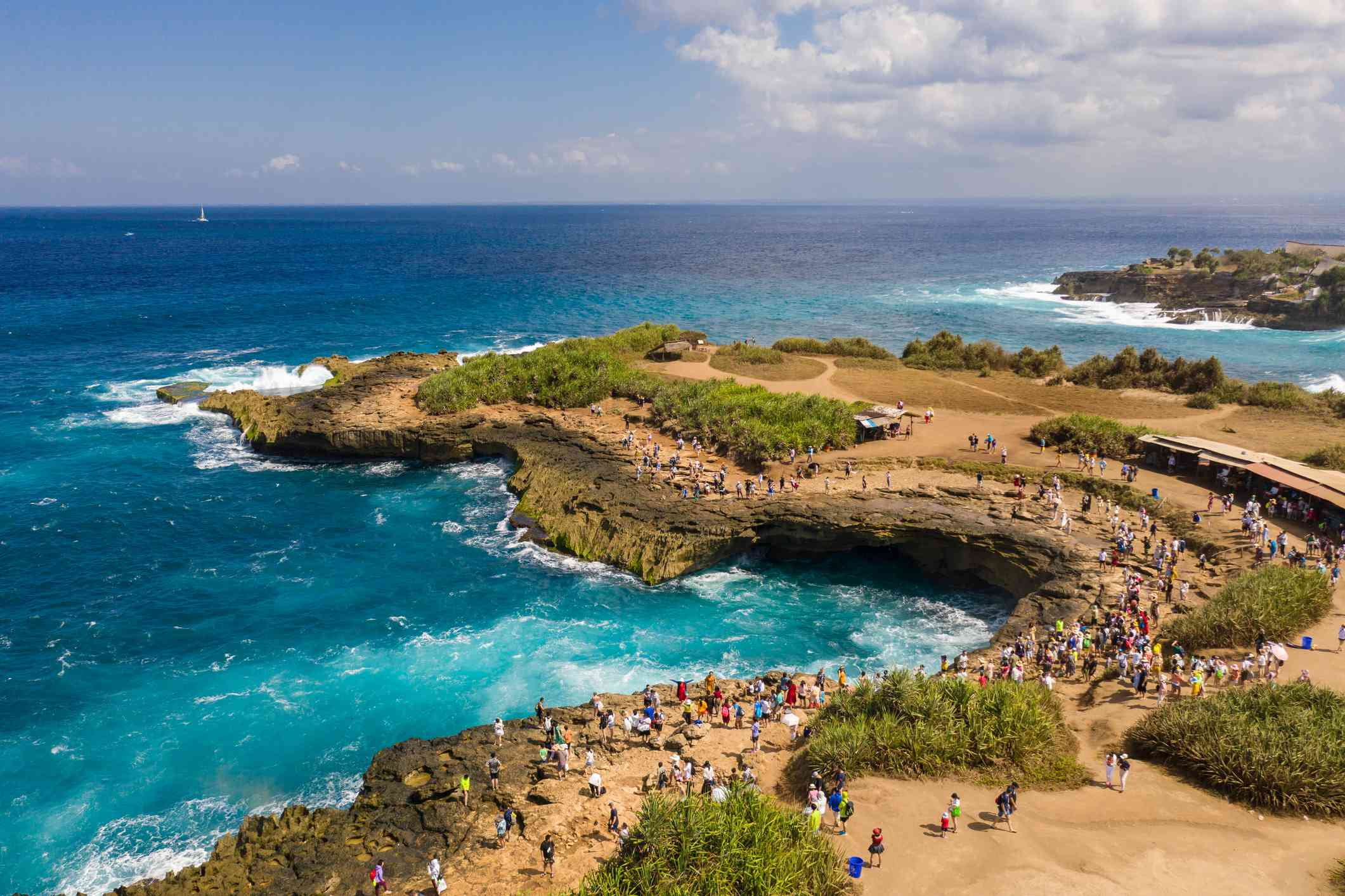 Aerial view of the famous Devil's tear in the Nusa Lembongan island in Bali, Indonesia.