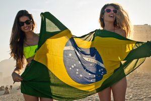 Two girls partying on the beach in Brazil