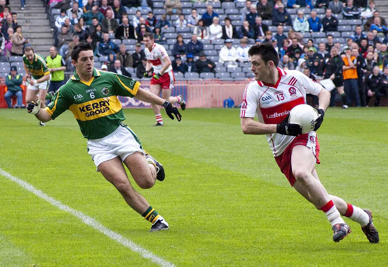 Kerry's Aidan O'Mahony and Derry's Eoin Bradley in action in the 2009 National League final.