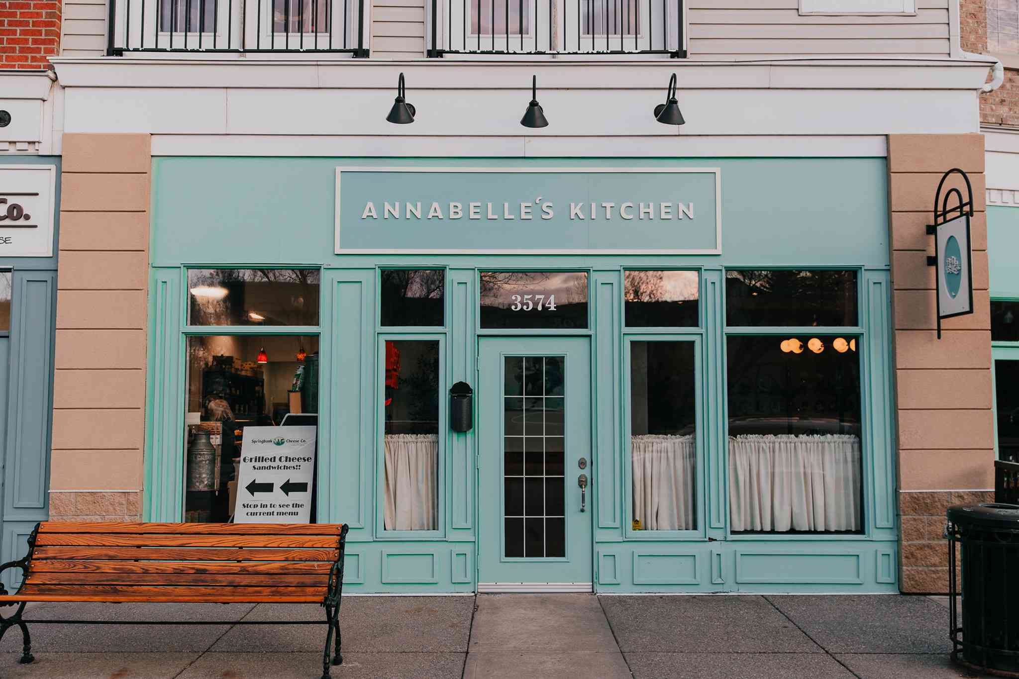 pale blue storefron with large windows and a sign that says Annabelle's Kitchen