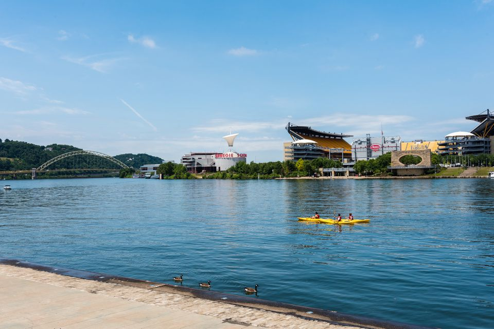 Three people in kayaks in Pittsburgh's Point State Park