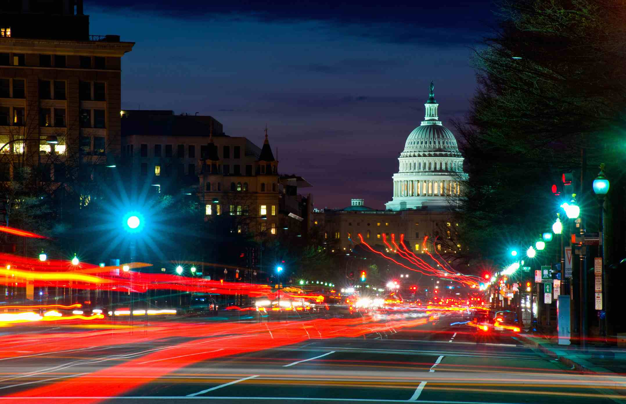 Traffic on the road with State Capitol Building in the background, Washington DC, USA