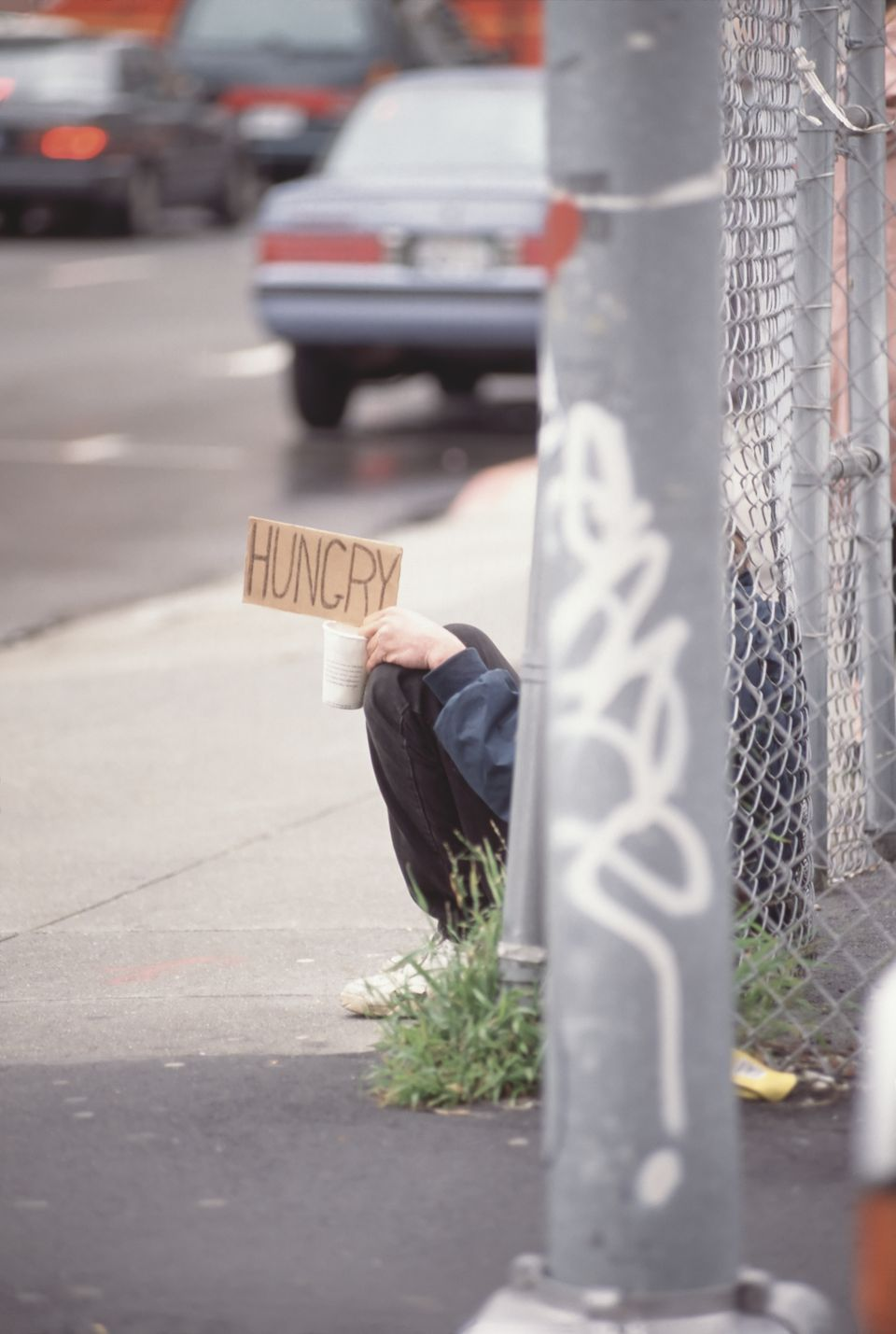 Homeless man holding a sign on the street