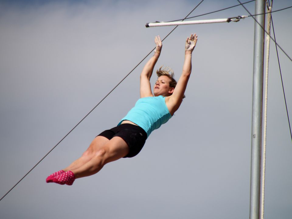 A woman flying from a trapeze