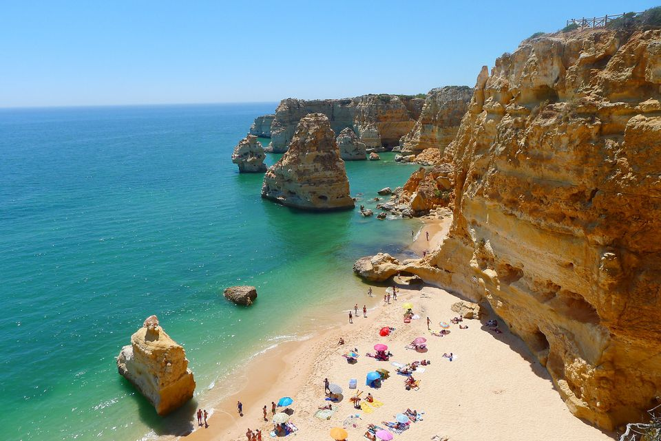 View from above of people on the beach at Praia da Marinha