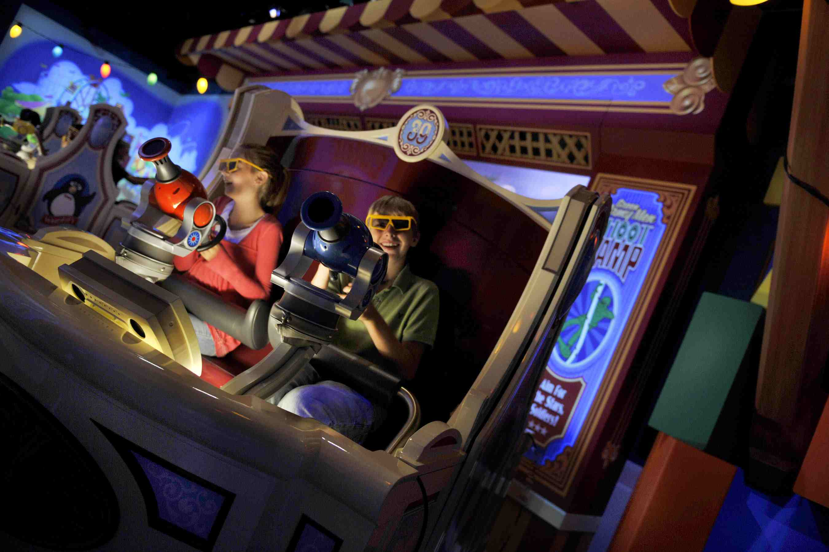 Inside Toy Story Mania with kids shooting at targets to gain points.