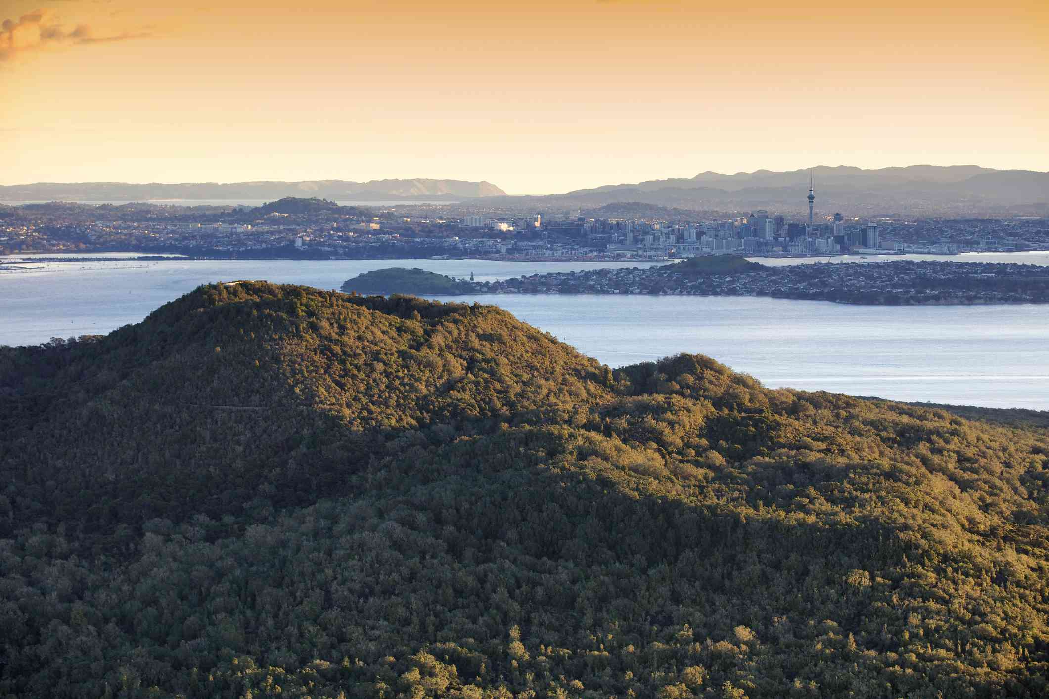 Aerial view over rangitoto summit to Auckland city, sunset