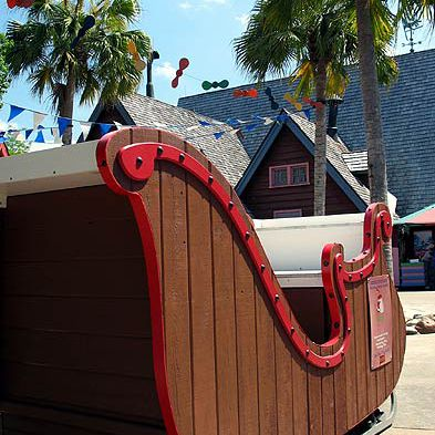 Whimsical touches include a snow sleigh against the backdrop of palm trees.