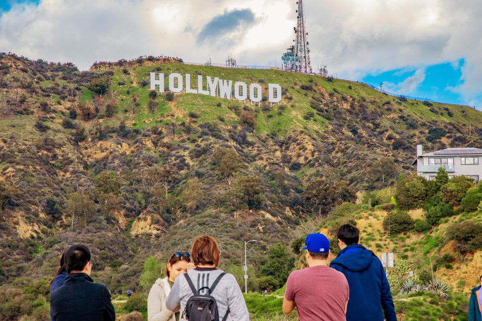 People looking up at the Hollywood Sign