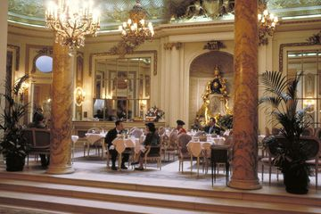 People having tea in the grand Palm Court of the Ritz