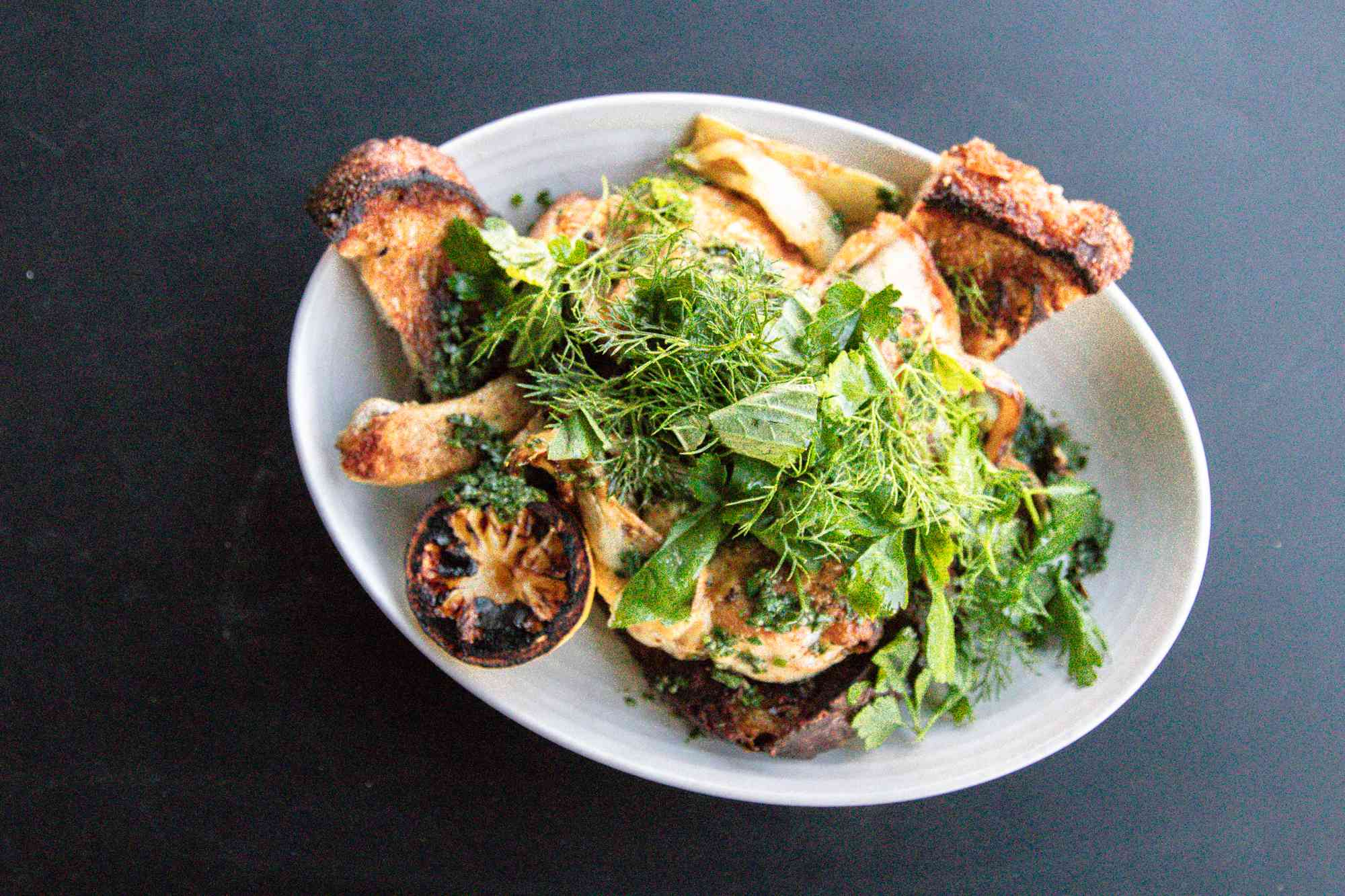 Toast and chicken garnished with greens from High Street on Hudson