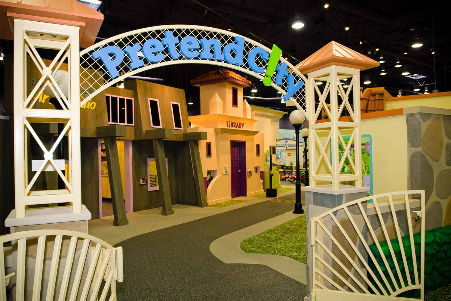 Indoor fake town with an entry gate that says Pretend C!ty