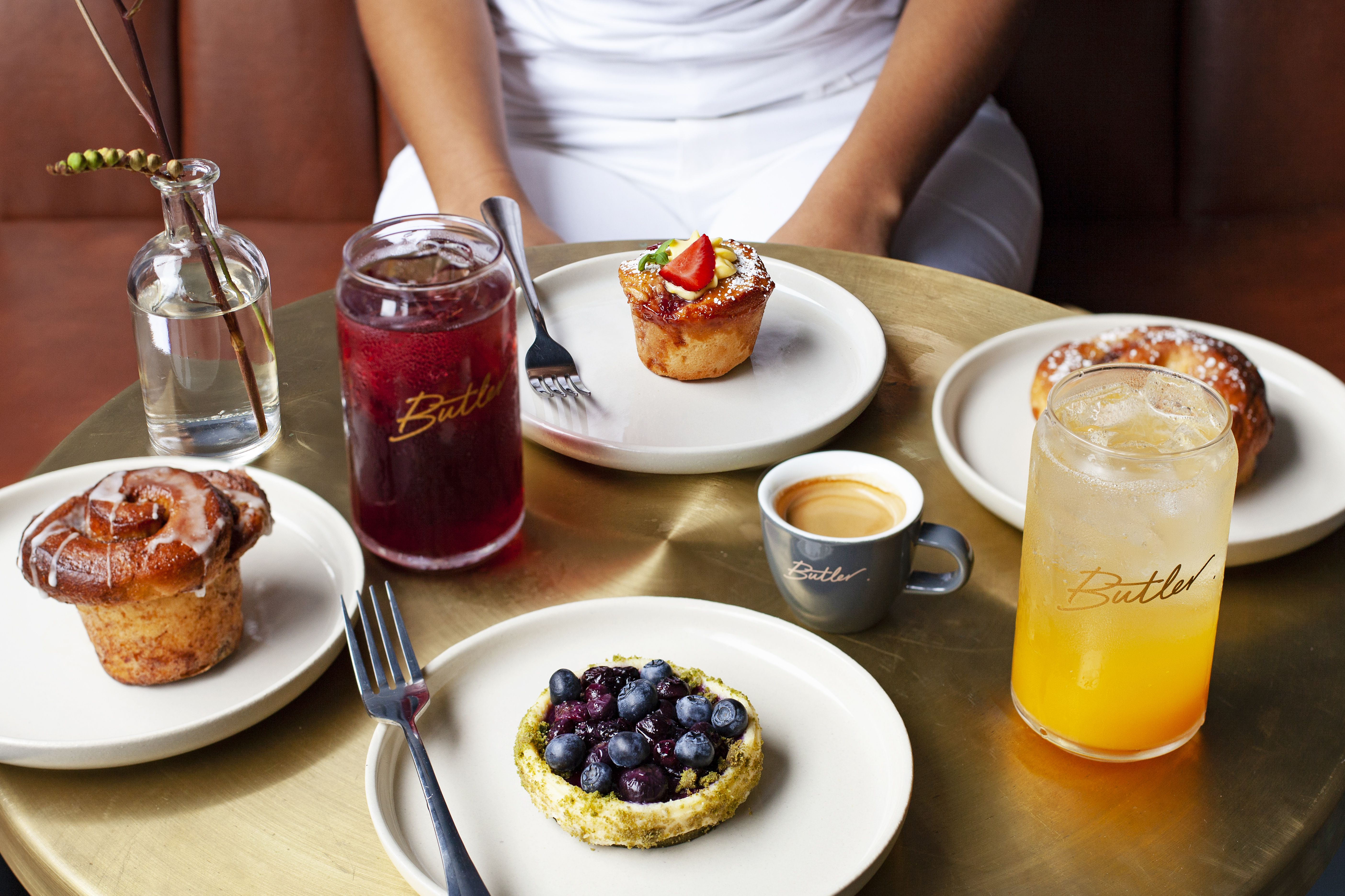 A table covered in delicious desserts and fruit drinks from Butler Bakery in New York City