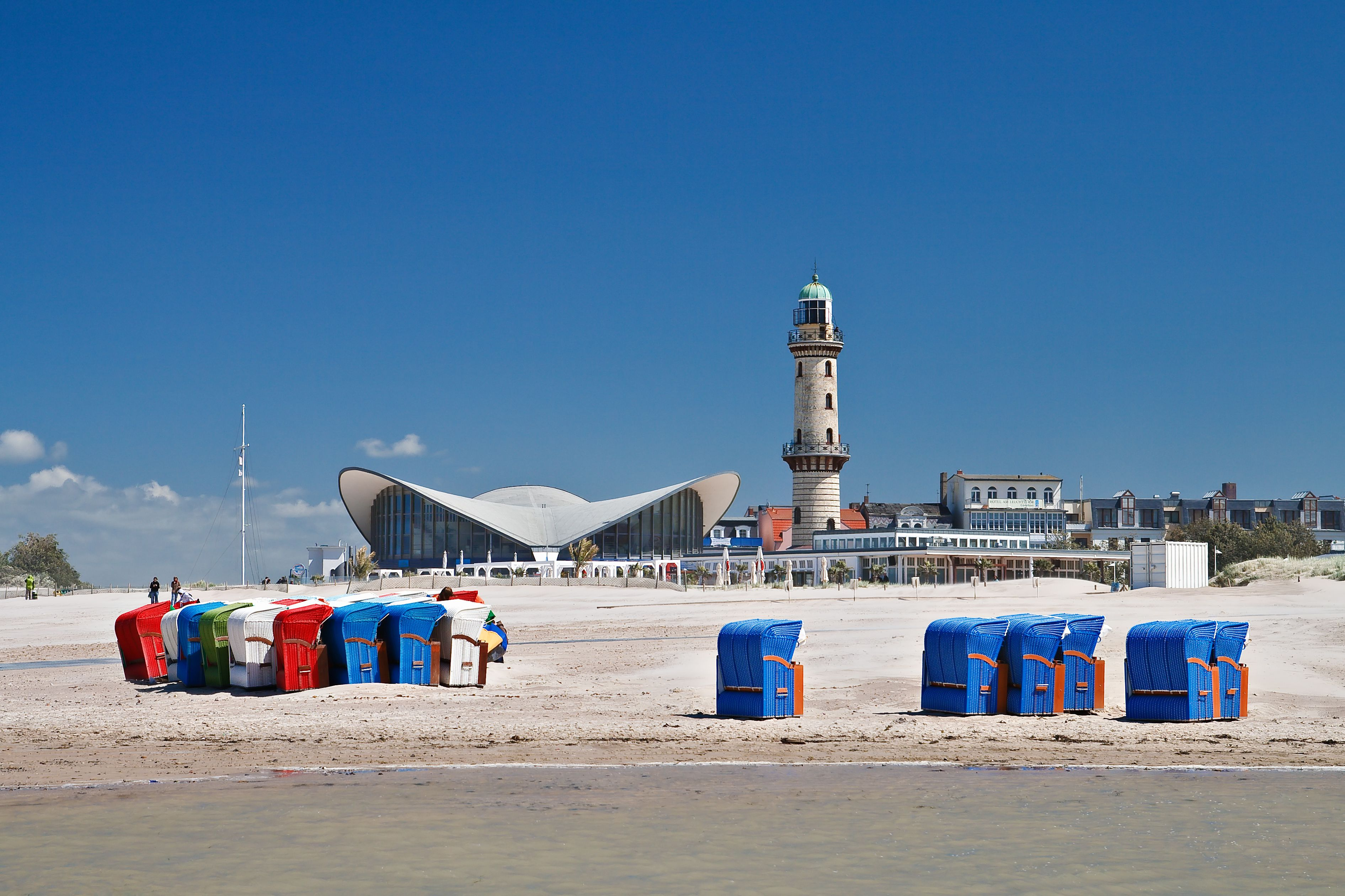 Lighthouse against blue sky at beach in Warnemnde, Germany