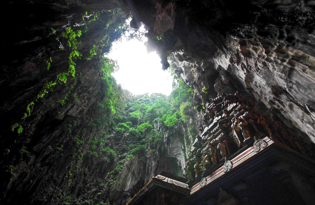 Carvins and a sun hole in the batu caves