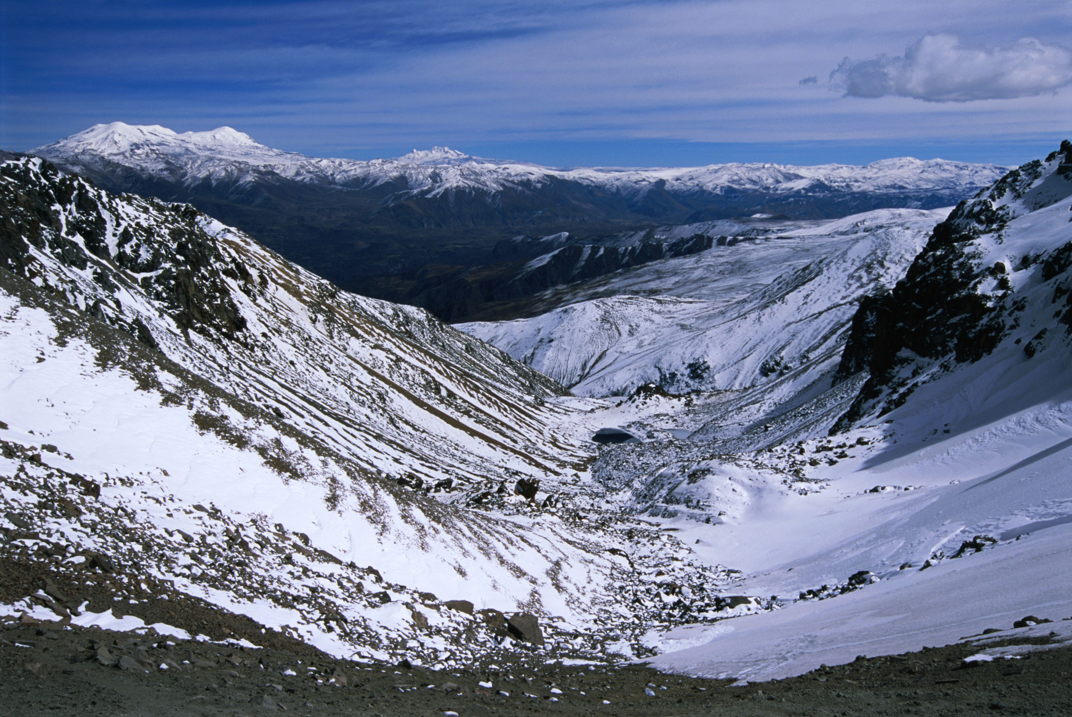 View westward from snowbound Cerani pass (5100m) with Coropuna (6425m) in the distance, on the Colca Canyon to Andagua trek.
