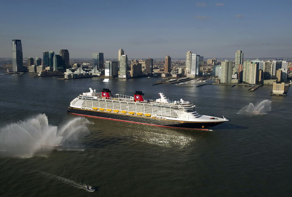 Aerial view of the Disney Fantasy cruise ship underway on the Hudson River with the New Jersey skyline in the background