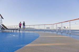 Young couple is jogging around the shipdeck of a cruise ship, Mediterranean Sea