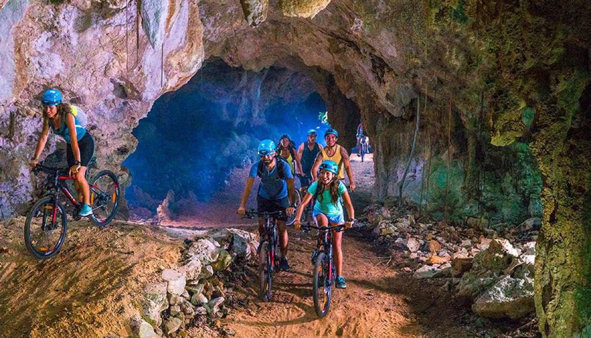 mountain biking through a cave