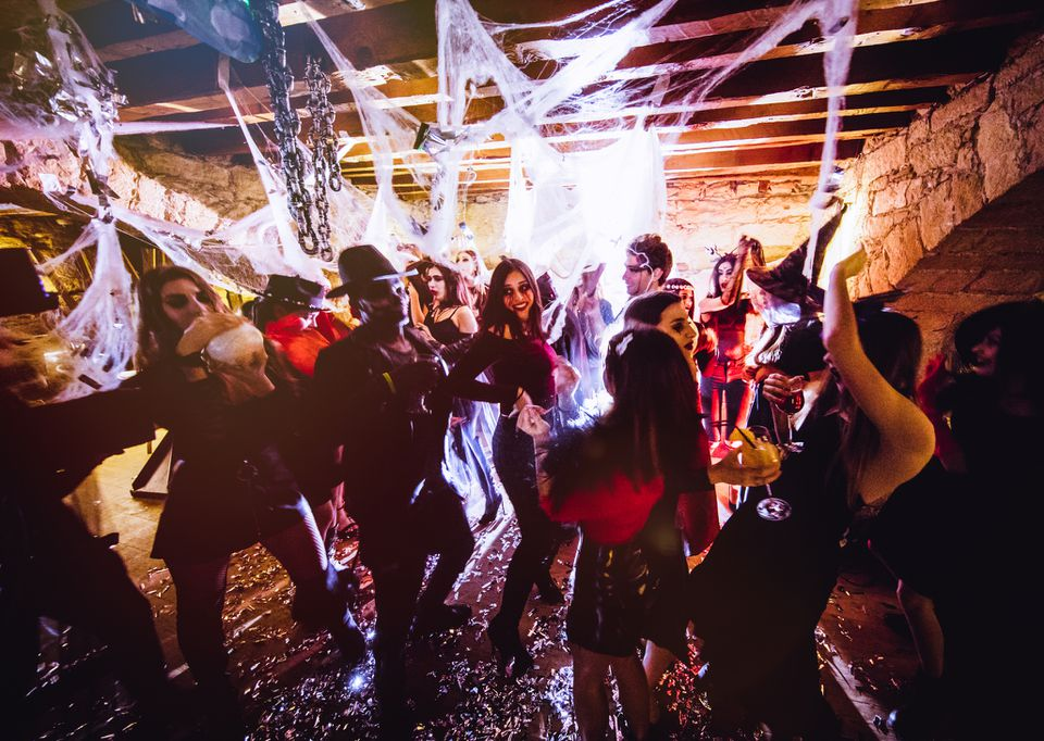 People in Halloween costumes having fun at dungeon nightclub