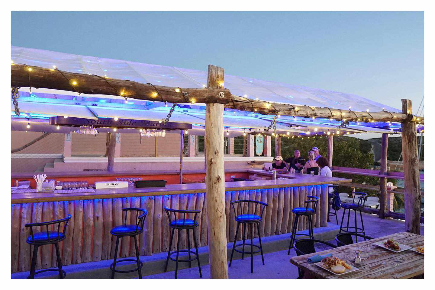 small covered beach bar with blue accent lights