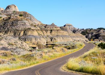 Curiving road going past the rock formations of Makoshika State Park