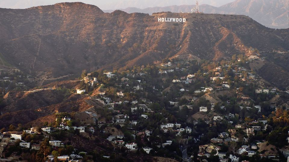 Aerial view of Hollywood sign over Los Angeles cityscape