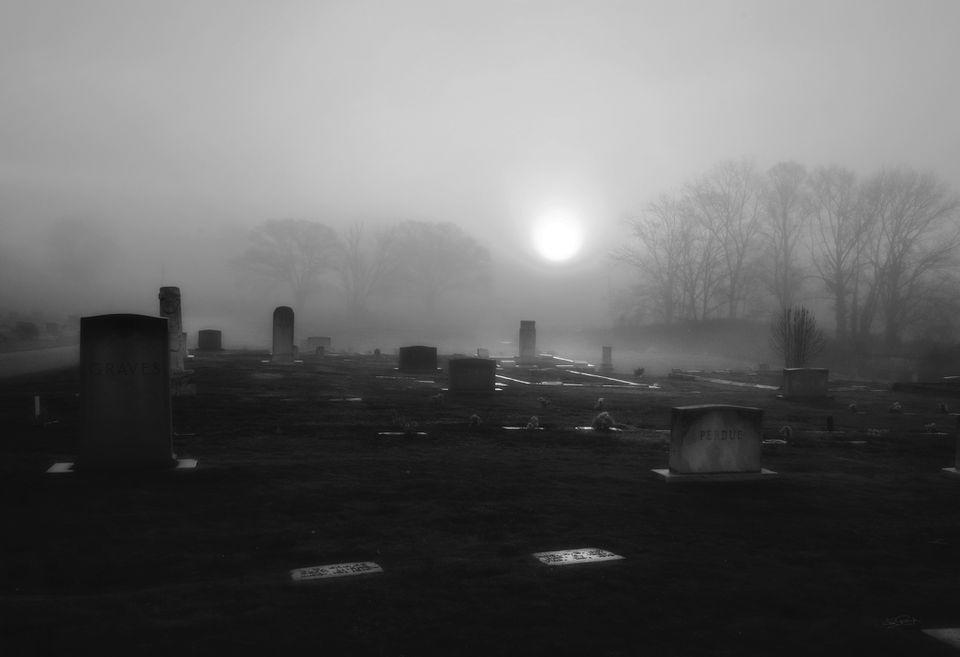 A misty, fog shrouded cemetary
