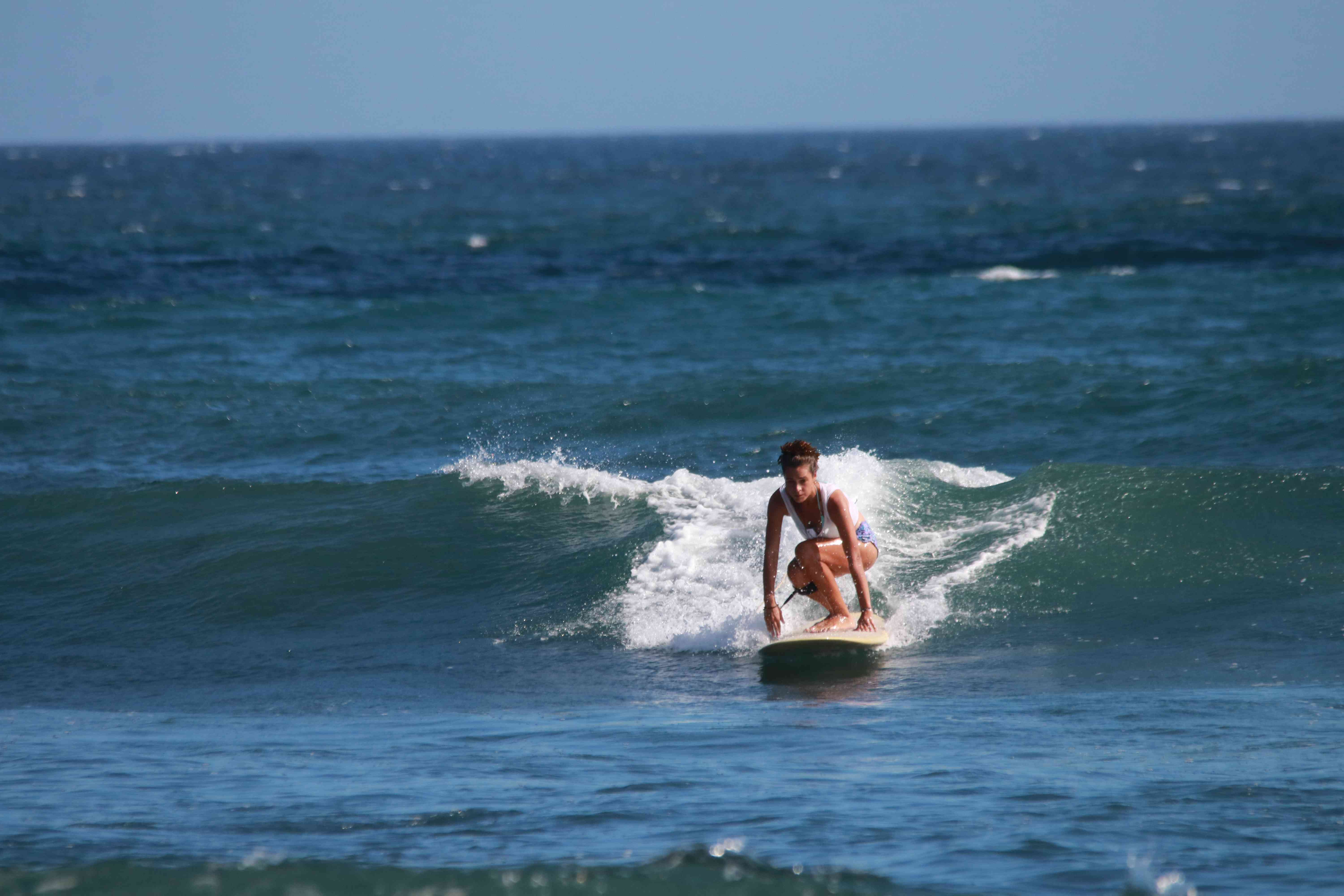 Woman learning to surf in Bali