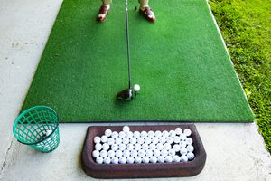 Golfer on Golf Driving Range with Driver Golf Club