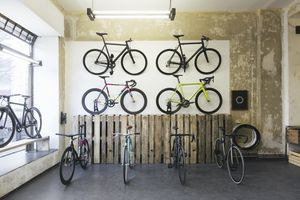 Save Assortment of racing cycles in a custom-made bicycle store - stock photo