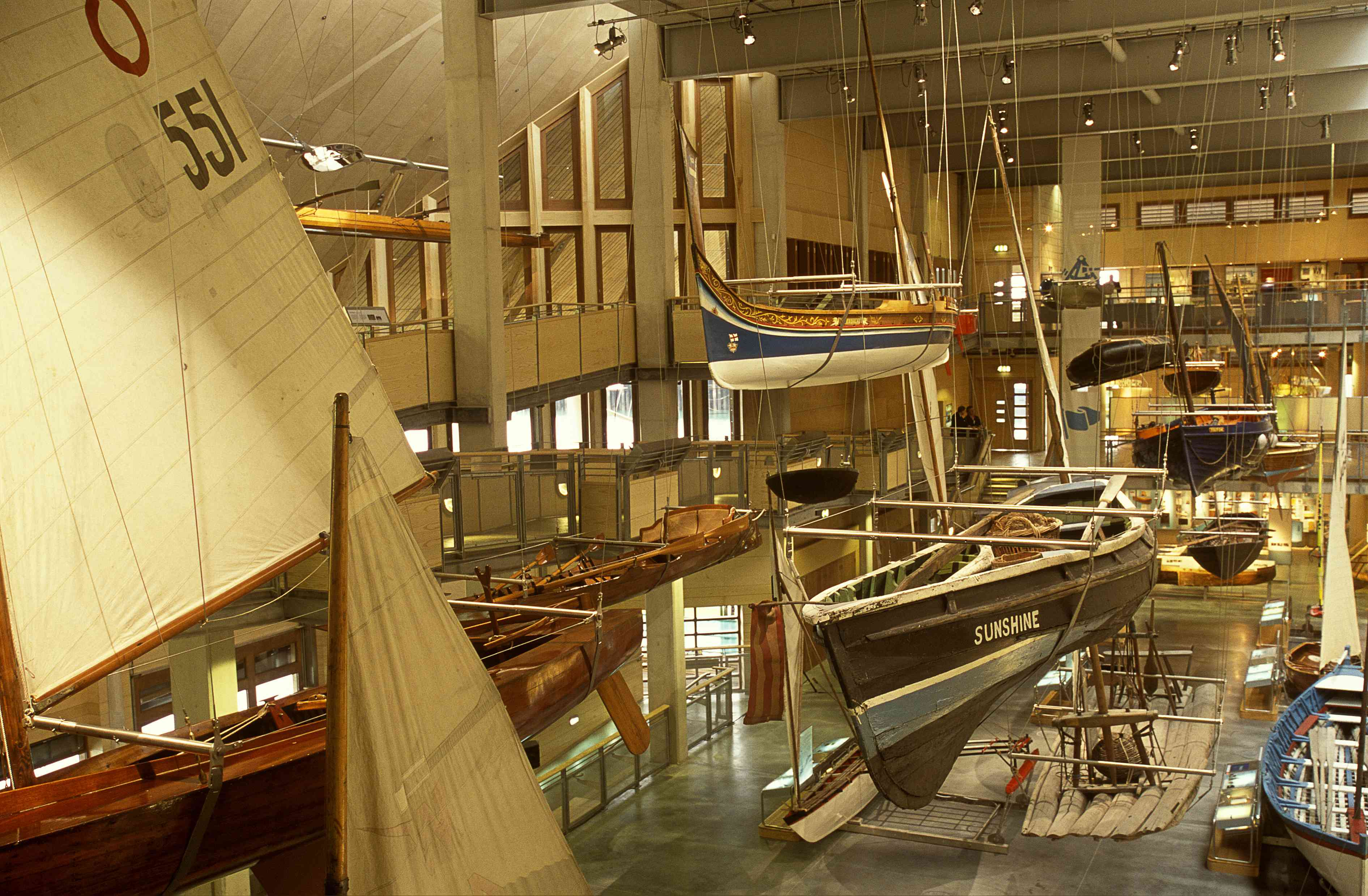 Collection of small boats on display inside the main exhibition hall at The National Maritime Museum Cornwall
