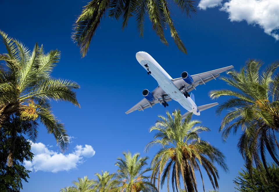 Airplane approaching landing on a tropical island