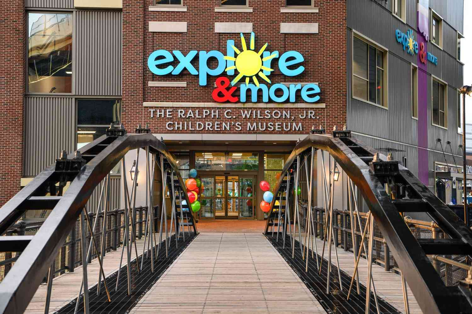 Entrance to the Explore & More Museum photographed from across a small footbridge