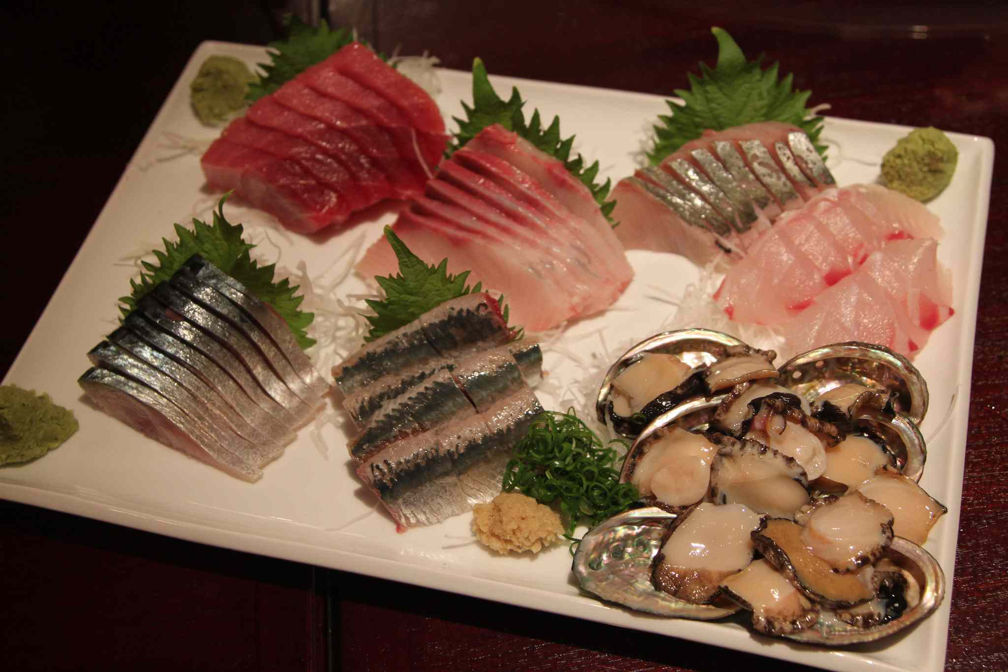 Sushi II, Hawaii—Jimoto Mebachi Maguro Chu Toro, Hamachi, Shima Aji, Opakapaka, Awabi, Iwashi and Saba Sashimi (starting from top left, going clockwise)