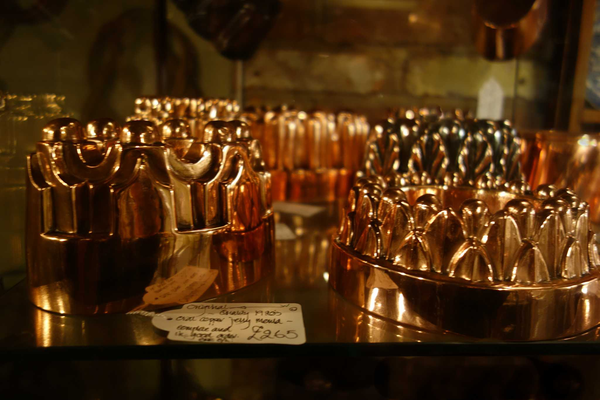 Copper Jelly Molds in an antiques shop