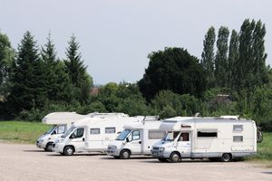 Different types of RVs parked.