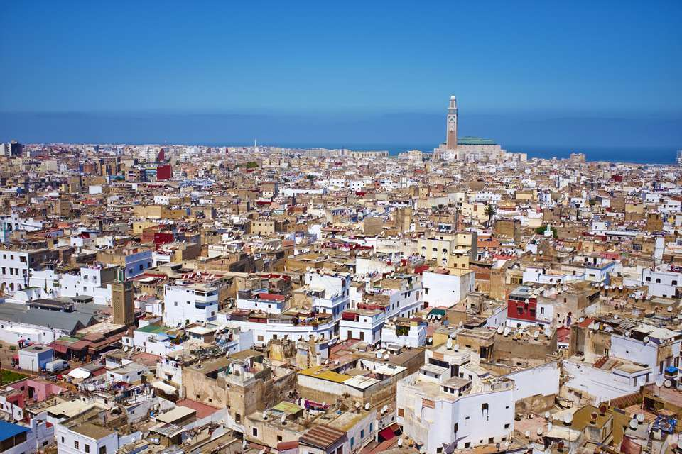 Wide-angle aerial view of Casablanca with Hassan II Mosque in the background
